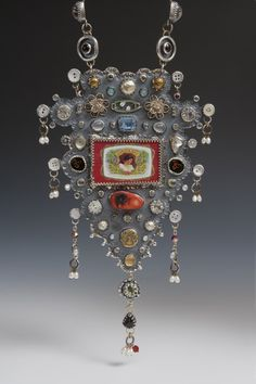 """Kristin Diener, Artist, Vainglory, 2010, necklace with handmade chain, sterling silver, fine silver, matchbox, shell and metal and glass buttons, opal, filigree, antler, gold peacock, apache tear, brass, fake and real pearls, cut glass gems, citrine, moonstone, peridot, garnet, simulated opals, glass cabochons, paper, found objects, mica, candy wrapper, 20"""" x 5.5"""" x .75"""""""