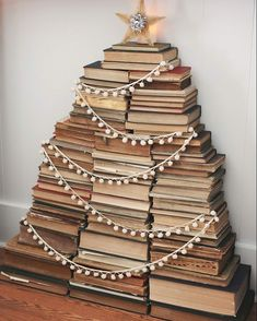 """A Dozen Favorite Creative Christmas Decorating Ideas! – Kelly Elko A Dozen Favorite Creative Christmas Decorating Ideas! Cute stacked Christmas book tree complete with shining star! One of a dozen creative Christmas """"trees"""" eclecticallyvinta… Book Christmas Tree, Merry Christmas, Creative Christmas Trees, Book Tree, All Things Christmas, Winter Christmas, Vintage Christmas, Christmas Holidays, Christmas Crafts"""