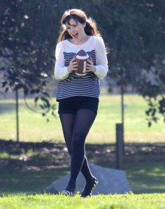 "Zooey Deschanel Adorkably Plays Football On The Set Of ""New Girl"""