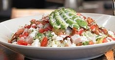 BJ's Cobb Salad    Chopped romaine and iceberg lettuce tossed with our special creamy garlic dressing and oven-baked seasoned croutons. Topped with roasted turkey, Applewood smoked bacon, feta cheese, tomatoes and avocado.