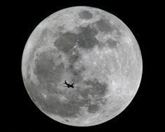 Florida photographer Isaiah Blount of Smooth Images submitted this picture of an airplane crossing the disk of the supermoon on Saturday night.