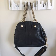 Givenchy Nightingale handbag Givenchy Nightingale medium handbag from 2007 signature collection with gold Studs and chain handles. Lambskin leather. Signs of wear. Good condition. Givenchy Bags