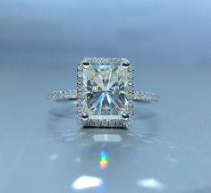9x7mm Radiant Cut Moissante set in a 14k White Gold Diamond Halo Setting
