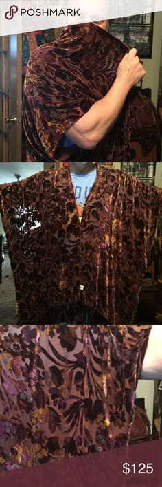 """SALE! Beautiful velvet burnout fringed kimono Yes that's my hubby. Lol! He likes his job! The color is hard to describe. The fabric is a velvet purple and mocha w/ highlights of gold in a floral burnout design on a silk chiffon back. It has a dark brownish purple fringe. Free size, I would say generously sized. My husband is 6' and weighs 230lbs and it was plenty oversized on him. The only tag says """"Shiba"""". It is in excellent used condition. Very striking! Color sort of changes as the…"""