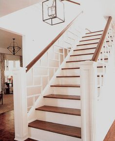 chunky white banister with top railing that matches the floor.