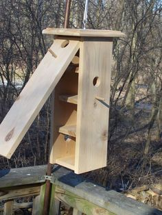 Handmade multilevel, cleanable birdhouse. Entrance to different nest on each side.