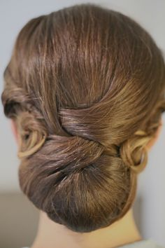 The classic chignon with romantic swirls and pin curls