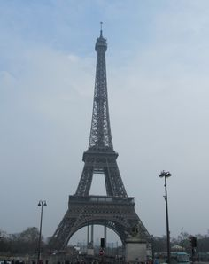 Paris, France - Eiffel Tower 1889:   1,049 feet tall, 15,000 separate pieces of metal, weighs 7,000 tons, 3 floors.