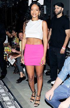 Rihanna wears a pink Versace mini skirt and earrings to Versus Versace S/S 15 show // #NYFW #SS15