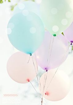 Big pastel colored ballons in a large bouquet.