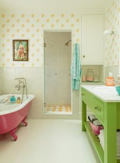 Green bathroom vanity and pink bathtub. Love the color of the vanity