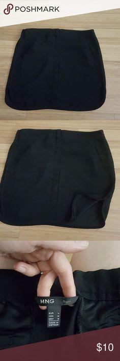 Black mini skirt Used once, cleaned just like new. Mango Skirts Mini