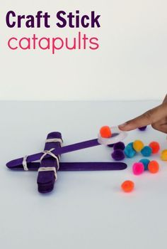 Awesome STEM Activity for Kids--Make a Craft Stick Catapult using wooden craft sticks, paint and pom poms!