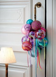 Dishfunctional Designs: Things You Can Make With Old Christmas Tree Ornaments. Festive Door Ornament. Love these jewel colors!