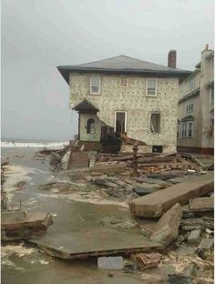 Learn! Regional Sea Level Changes - A Tale of Two Cities. part of #GETSI collection. Changing Ice Mass and Sea Level #UNAVCO #Education #Module #GPS #geodesy #free #college #undergraduate #LessonPlan This photo:House in Brooklyn damaged by Super Storm Sandy