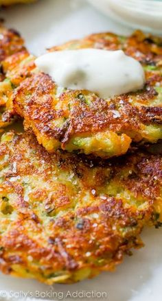 Golden brown, crisp, and light zucchini fritters! Learn the trick to getting them EXTRA crisp on sallysbakingaddiction.com