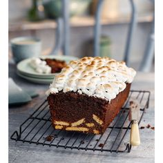 A US campfire treat, a s'more is a hot toasted marshmallow and chocolate sandwiched between two graham crackers. We've taken the flavours and made a cake! For more chocolate cake recipes visit Goodhousekeeping.co.uk