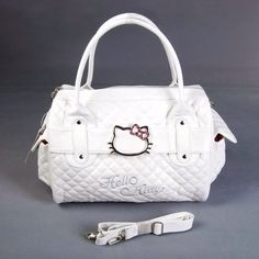 Hello Kitty Shopping Bag Handbag Tote Purse White. Hello Kitty shaped buckle on the front, with diamonds shining on it. Top zipper closures.