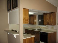 Small, ugly 1980s kitchen finally remodeled!, Our kitchen was a small galley kitchen. You could stand in one place and touch the sink, stove and ceiling. We took out the dining room and added a buffet and glass front cabinets. We now have a spacious island to work and eat at., 80s kitchen before.Small galley kitchen, dropped ceiling.  , Kitchens Design