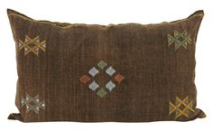 Similar to our unique collection of floor pillows, we have also sourced a number of sofa and chair sized pillows made from Moroccan Rugs. Our Moroccan Pillow Group includes a wonderful assortment of Sabras and Kilims in colors ranging from neutrals to muted tones and rich colors. All have coordinated piping on the edge, some with tassels and others without. Each is totally unique and a one-of-a-kind work of art for your home.    •cotton or wool  •coordinating piped edges  •zipper closure…