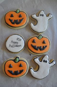 Halloween Cookies, I actually made!  I experimented with the stamp/edible pen method (difficult because it's hard to make the royal icing perfectly flat - fondant may be better).  The royal icing worked fine, I just got lazy and didn't wait 8-10 hrs for the first layer to dry and the ghosts' eyes bled a little bit.  The stamped one looks blah, but I have others that are blank.  I'll let the kids draw on those ones w/ the edible ink pens.  @Cathy Olsen @Emily Hickey @Rebecca Hatch