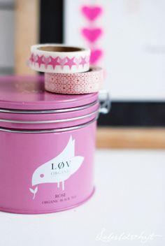 pink tin with bird