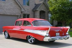 57 chevy. My mom had a cocoa-brown and white Chevy BelAir with slightly smaller tail fins.  Awesome & solid as a rock!