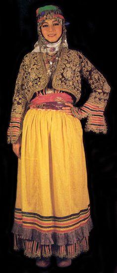 Europe | Portrait of a young woman wearing a traditional wedding dress, Aydin, Germencik, Turkey