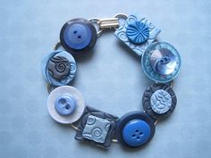 One of a kind bracelet from my hand-stamped polymer clay tiles and upcycled vintage buttons.