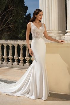 Intricate beading heavily adorns the illusion bodice of this fit and flare gown. You will stun your guests as you sparkle walking down the aisle. The open keyhole back completes the look. This style is also available with the front bodice lined to the side seams.