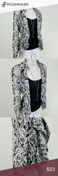 Open front lace jacket Long-sleeved lace jacket in black & white with waterfall / ruffled open front accented by decorative zippers & snap.  Back length 18.5 / front length 24 inches.  75% cotton, 25% nylon.  Check out the rest of my closet to bundle & save!  Over 150 listings available with new listings every week! INC International Concepts Jackets & Coats
