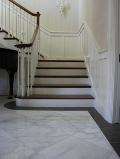 Love this. Floor Tile - black border really works. Chocolate Brown would look good too. Also love wainscotting on stairway.