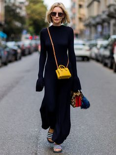 Forget the shoes. All about this dress and colorful bags.