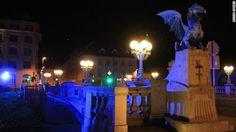 The Dragon Bridge in Ljubljana, Slovenia, is illuminated to commemorate World Autism Awareness Day