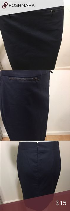 Calvin Klein navy pencil skirt with zippers Slimming pencil skirt by Calvin Klein. One zipper on each side on the front of the skirt. Invisible zipper down the back of he skirt. Calvin Klein Skirts