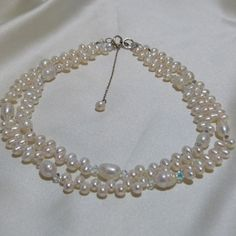 Check out this item in my Etsy shop https://www.etsy.com/listing/123226504/double-strand-freshwater-pearl-bridal