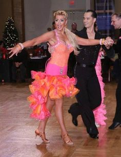 https://www.facebook.com/photo.php?fbid=10152900111854424 Enjoying American Rhythm at Holiday Dance Classic.  With Charlene Proctor and Michael Choi 2014
