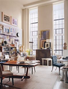 Thomas O'Brien.  eclectic loft with large windows and a lot of stuff, how to make it loook good