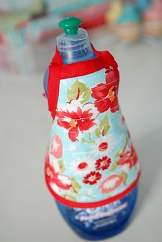 What a cute housewarming or bridal shower gift.  Apron for dish soap bottle. :-)