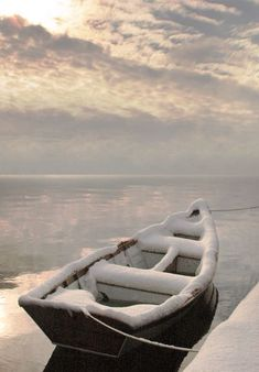 Winter | Rowboat in snow on the cold bay