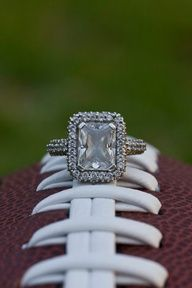 football themed engagement photos - uh, yeah, I just want the diamond...