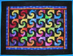 Pictures of Quilts with a Circular Theme: Twisted Daughter Quilt.  Snail trail