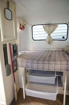 I like this bed/storage idea for my camper