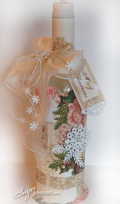 Christmas Bottle- love the tiny snowflakes on the twine, the pretty ribbon