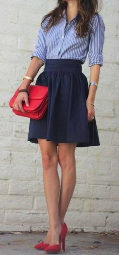 high-waisted navy skirt with blue striped shirt, red clutch and red heels.