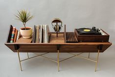 This gorgeous home audio mid-century-minded console promotes the use of your vinyl collection. Beautifully crafted in Walnut by Sitskie, a Detroit-based design studio, the Open 45 Credenza lets you proudly display your wonderful collection by keeping Esstisch Design, Muebles Living, Vinyl Record Storage, Furniture Collection, Furniture Design, Modern Furniture, Outdoor Furniture, Tree Furniture, Futuristic Furniture