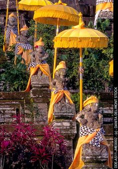 Indonesia, Bali. Pura Temple Besakih. Statues at Mother Temple adorned in yellow for Shiva