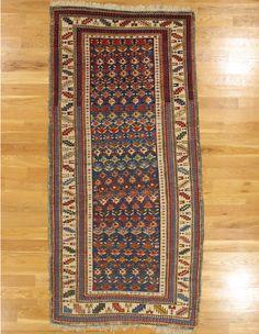 "Kuba rug,Eastern Caucasus,circa 1875, 7'.4""x3'.5"" (224x104 cm)."