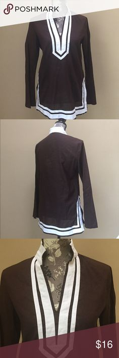 """Michael by Michael Kors tunic top Michael by Michael Kors brown and white tunic top. Size 6.  Excellent condition. 19"""" from under arm to underarm and 27"""" from shoulder to bottom.  100% cotton.  Really cute! Cut out sides. MICHAEL Michael Kors Tops"""