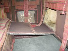 """1815-20 ca. Interior Travelling Chariot  This type of carriage was used for long journeys, such as the Grand Tour of Europe, which every young nobleman and gentleman of substance made in the 18th and early 19th centuries. The extension on the front of the body is known as a """"dormeuse boot"""". It has folding panels which can be let down to enable the inside passengers to stretch out at full length into the boot and sleep while they travelled. nationaltrustcollections.org.uk"""